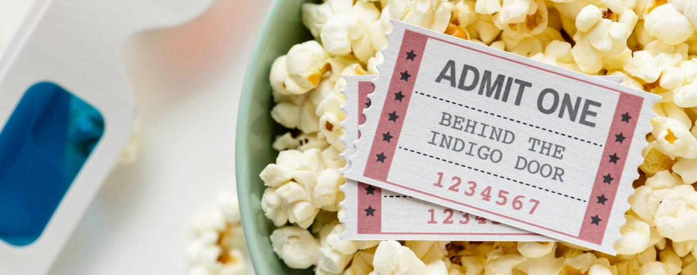Bowl of popcorn with two cinema tickets
